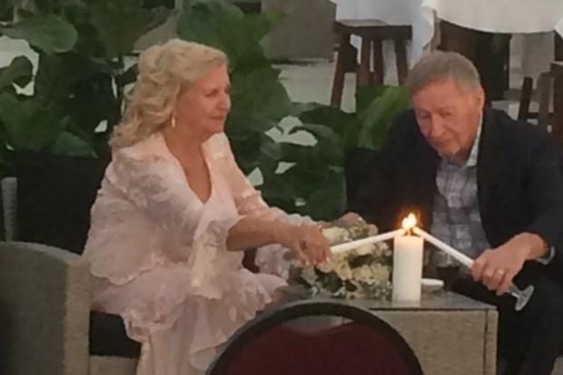 Former Senior Christian singles light candles together