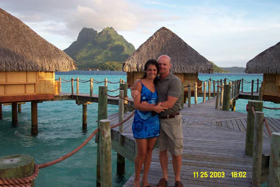 Christian dating site owner cuddles his wife in beautiful Bora Bora