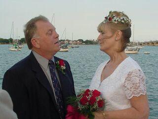 Senior Christian couple marry overlooking the ocean