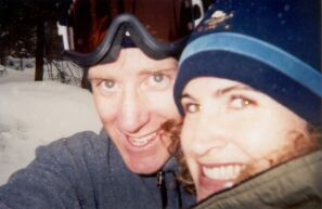A pretty redheaded Christian woman takes a selfie while out skiing with her date