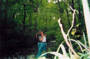 Christian singles hug in the forest while on a hike