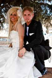 Alberta Christian single hugs his lovely wife