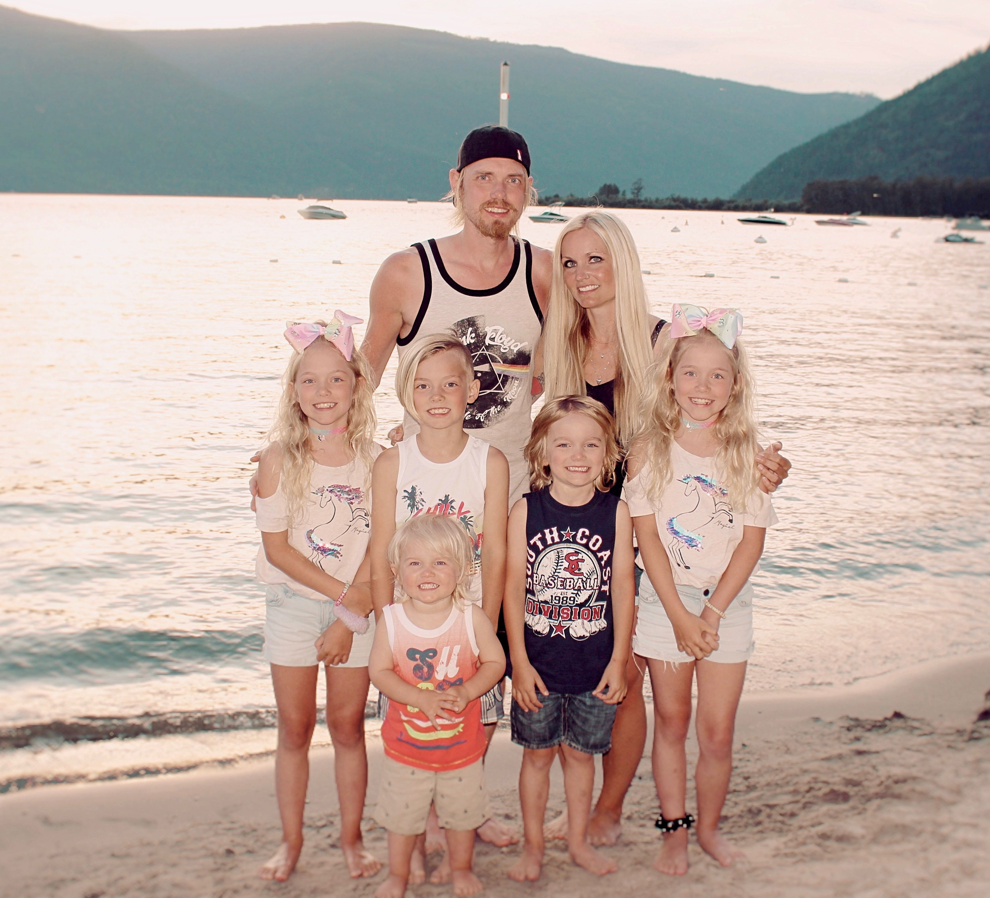 Christian couple at the beach with their 5 beautiful children