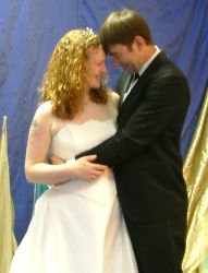 A couple dance and lean close together on their wedding day