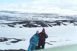 Brazilian Christian woman and Sweden Christian man in the mountains in the arctic