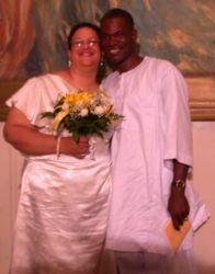 Interracial couple smile broadly on their wedding day