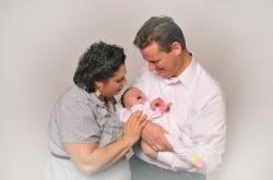 Alyssa and Bill lovingly hold precious Hannah Rose