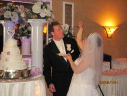 Alyssa feeds Bill some wedding cake