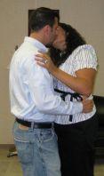 A Christian couple kiss tenderly indoors