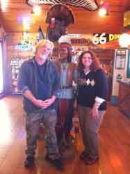 A happy couple pose inside a general store