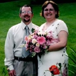 Midwest Christian singles find love and pose together with wedding flowers on the grass