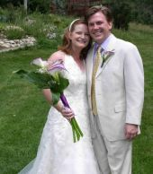 Christian friend smiles with her soulmate at their outdoor wedding