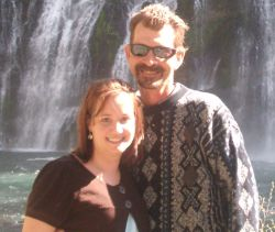 Cut Christian singles smile and pose together in front of a waterfall