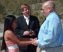 Arizona outdoor wedding for Maryland Christian single who holds his bride to be's hand