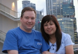 An American Christian single sits next to an Asian Christian woman in Singapore