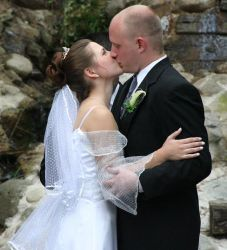 Michigan Christian singles now married kiss on their wedding day