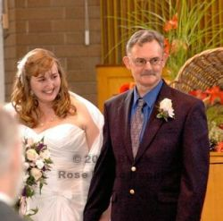 BC Christian singles marry and are full of smiles while walking down the aisle