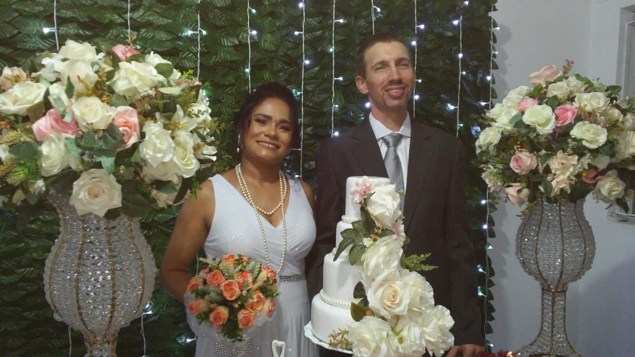 Married couple surrounded by flowers