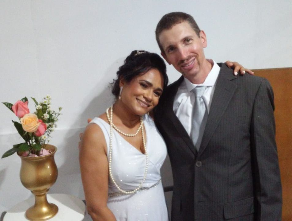Brazilian formerly single Christian smiling with American Christian husband