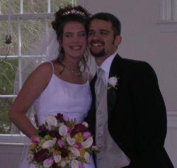 Joyful born again Christians embrace on their wedding day