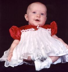 Cute baby girl in white and red dress