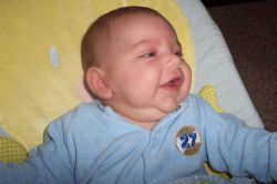 Cut baby in blue laughs