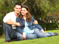 Cute couple cuddle on the grass