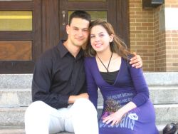 Christian singles sitting together and looking very comfortable while seated on steps