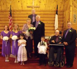 Wedding for widowed Christians at a church surrounded by flower girls