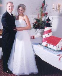 Michigan Christians hug happily next to their wedding cake