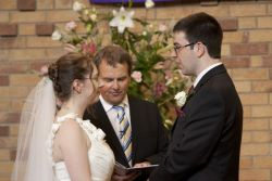 Ben and Katherine exchanging their vows