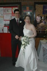 Katherine can hardly contain her joy as she stands next to her well dressed husband