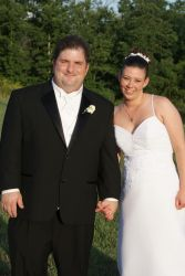 Newly married Christians laugh and hold hands