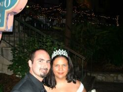 A Christian bride wearing a wedding tiara smiles next to her new husband at their wedding