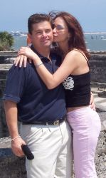 Lucky Florida Christian single receives a hug and kiss from a beautiful woman