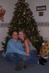 California Christian singles cuddle by a Christmas tree