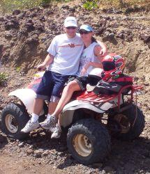 A couple relax on an ATV
