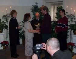 A Christian couple exchange their vows in front of family and friends