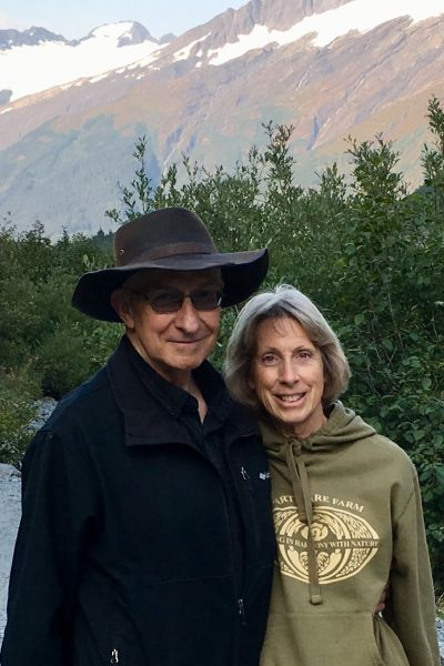 Alaskan scenery behind Carl and Carolyn