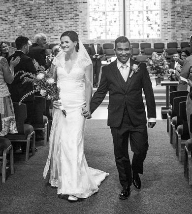 Pennsylvania Christian singles just fit together as they walk down the aisle smiling and holding hands after marrying at church