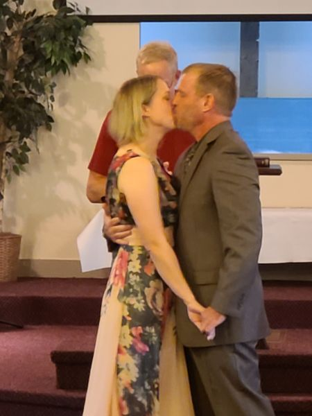 Kiss at the altar for Christian couple