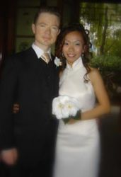 Australian Christian single stands next to his beautiful bride from Singapore