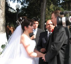 CT Christian ex-single faces his new bride from Mexico as they exchange their vows outdoors