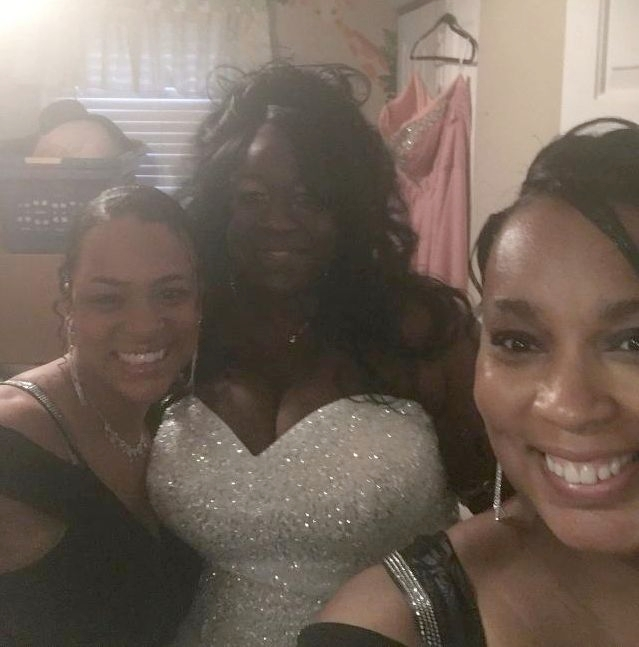 A radiant bride takes a selfie with her bridesmaids