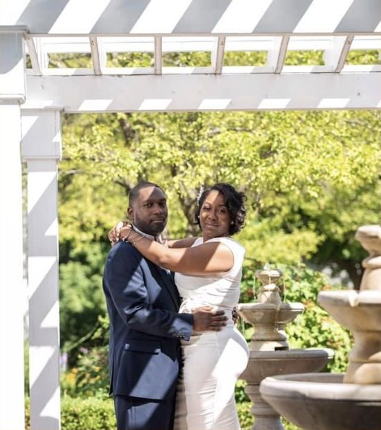 Newly married Christian couple hugging in garden