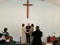 Cherie and James exchanging their vows