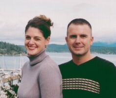 Cute Christian couple smile together in harbour