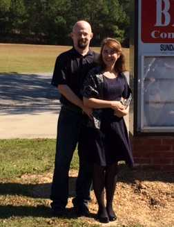 Chris and Ligia outside church