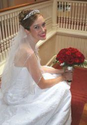 A radiant bride looks beautiful in white holding her flowers