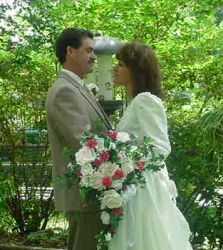 Newlywed Christians hold each other and gaze lovingly